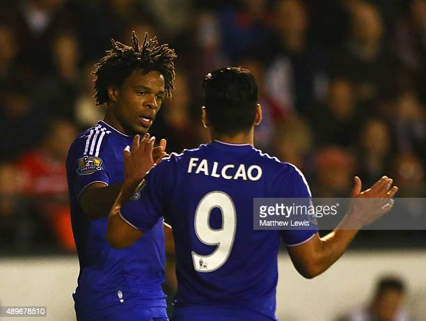 Loic Remy of Chelsea celebrates with Radamel Falcao Garcia as he scores their second goal during the Capital One Cup third round match between...