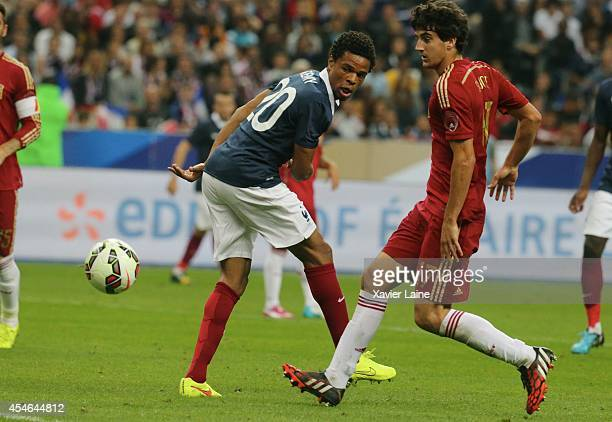 Loic Remy of France and Mikel San Jose of Spain during the International Friendly match between France and Spain at Stade de France on september 04...