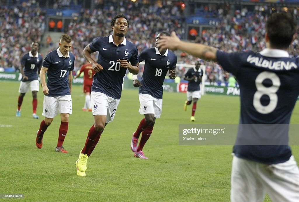 Loic Remy of France celebrate his goal with Mathieu Valbuena during the International Friendly match between France and Spain at Stade de France on...