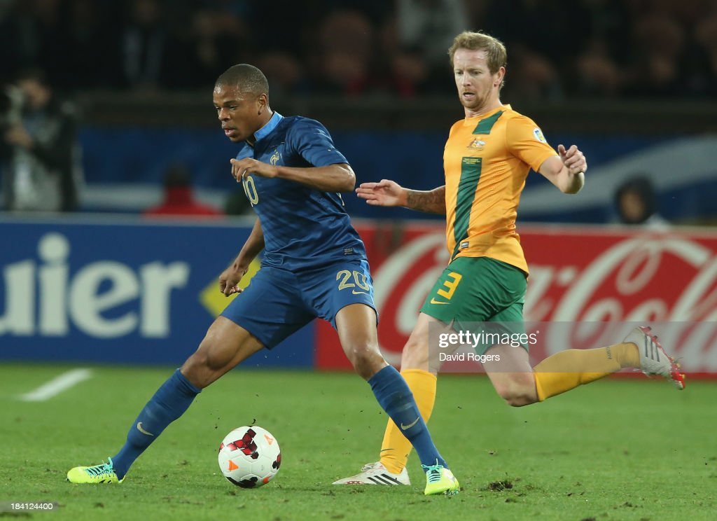 Loic Remy of France is watched by David Carney during the International Friendly match between France and Australia at Parc des Princes on October 11, 2013 in Paris, France.