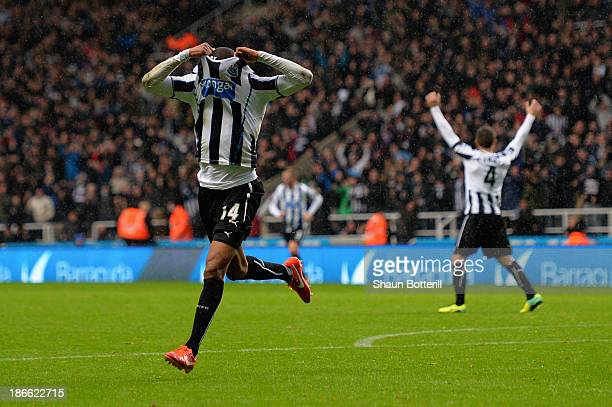 Loic Remy of Newcastle United celebrates scoring their second goal during the Barclays Premier League match between Newcastle United and Chelsea at...