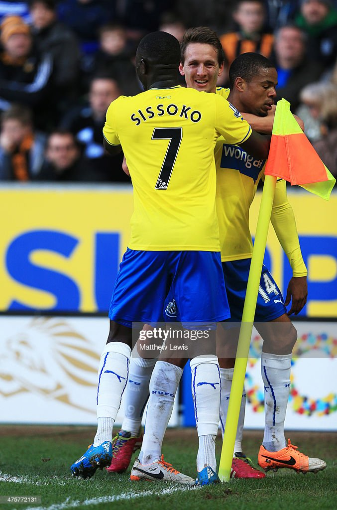 Loic Remy of Newcastle United (R) is congratulated by <a gi-track='captionPersonalityLinkClicked' href=/galleries/search?phrase=Moussa+Sissoko&family=editorial&specificpeople=4191251 ng-click='$event.stopPropagation()'>Moussa Sissoko</a> (L) and Luuk de Jong (C) as he scores their second goal during the Barclays Premier League match between Hull City and Newcastle United at KC Stadium on March 1, 2014 in Hull, England.