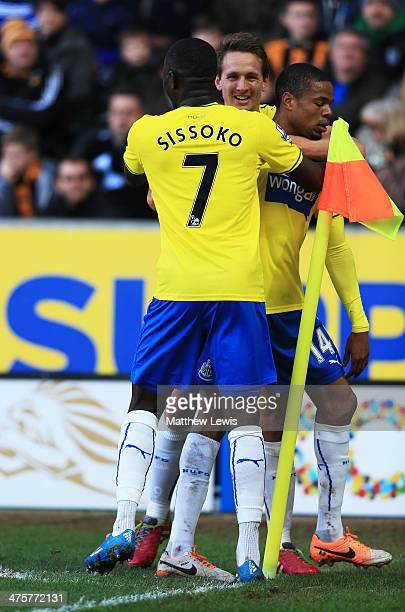 Loic Remy of Newcastle United is congratulated by Moussa Sissoko and Luuk de Jong as he scores their second goal during the Barclays Premier League...