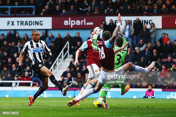 Loic Remy of Newcastle United scores his teams second goal during the Barclays Premier League match between West Ham United and Newcastle United at...