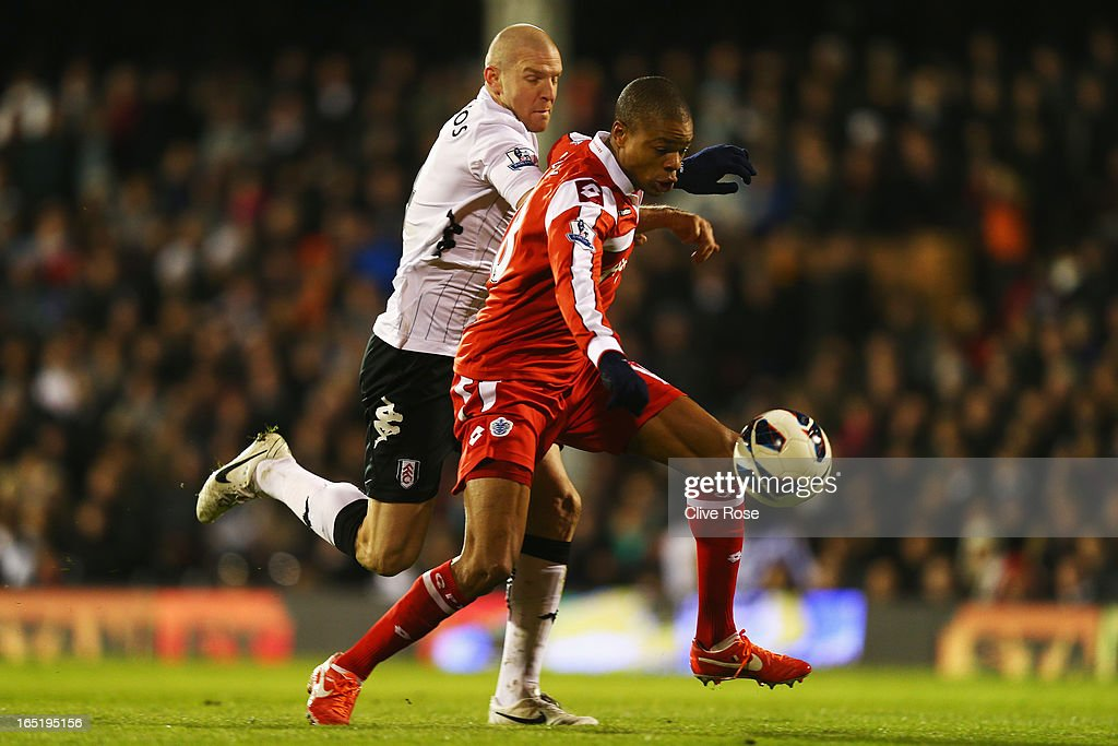 Loic Remy (R) of Queens Park Rangers holds off the challenge of <a gi-track='captionPersonalityLinkClicked' href=/galleries/search?phrase=Philippe+Senderos&family=editorial&specificpeople=221471 ng-click='$event.stopPropagation()'>Philippe Senderos</a> of Fulham as he goes on to score his sides second goal during the Barclays Premier League match between Fulham and Queens Park Rangers at Craven Cottage on April 1, 2013 in London, England.
