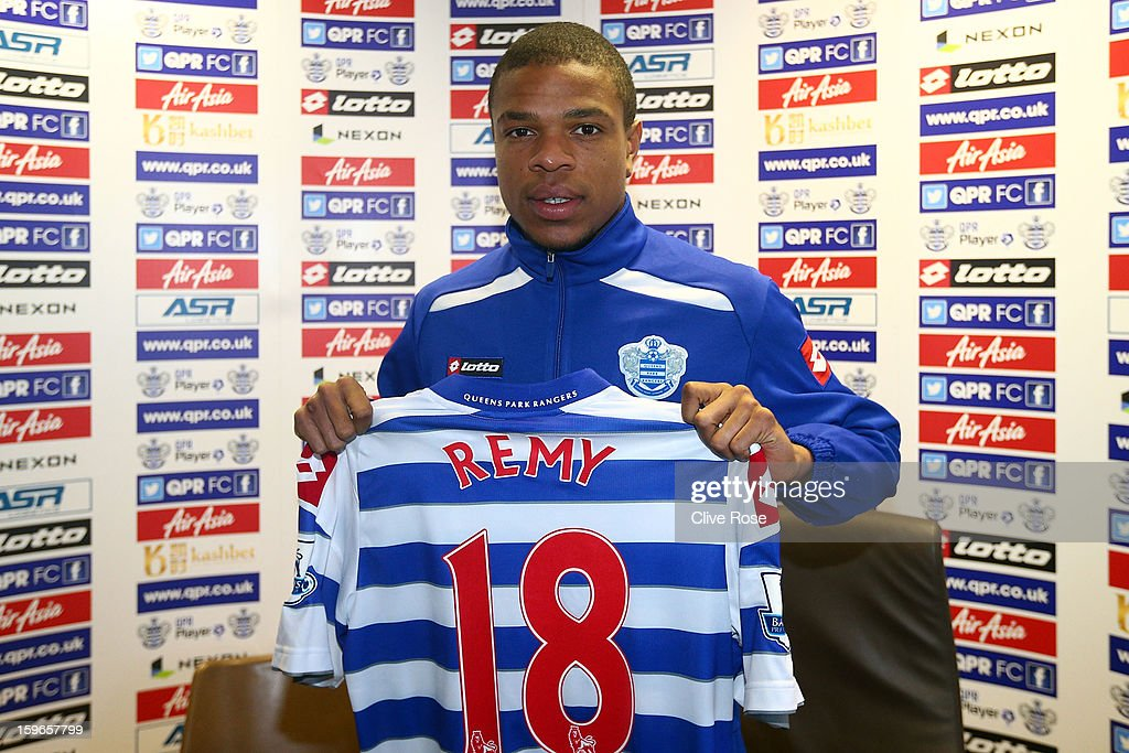 Loic Remy of Queens Park Rangers poses with his new shirt during a press conference to announce his signing to the club on January 18, 2013 in Harlington, England.