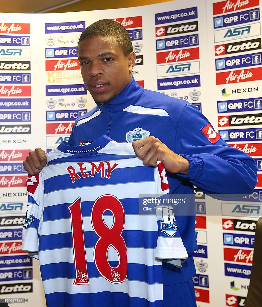 Loic Remy of Queens Park Rangers poses with his shirt during a press conference to announce his signing on January 18, 2013 in Harlington, England.