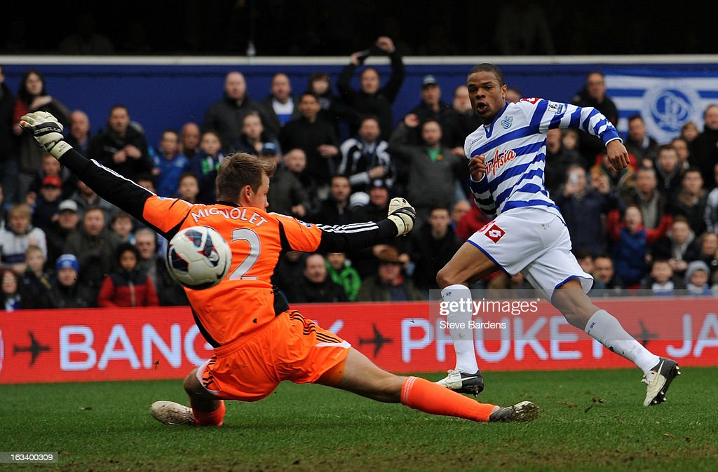 Loic Remy of Queens Park Rangers scores their first goal past Simon Mignolet of Sunderland during the Barclays Premier League match between Queens Park Rangers and Sunderland at Loftus Road on March 9, 2013 in London, England.