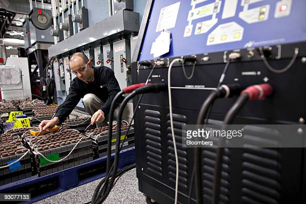 Loie Gaillac senior lead engineer for Edison International takes electrical readings during battery testing at a electric vehicle tech center in...