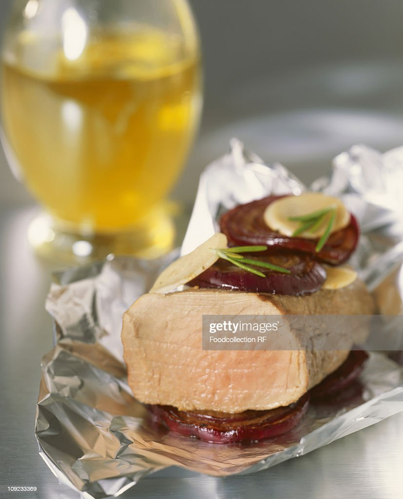 Loin of veal with aubergines cooked in foil, close-up : Stock Photo