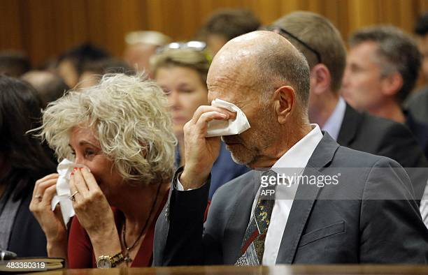 Lois and Arnold Pistorius aunt and uncle of South African Paralympic athlete Oscar Pistorius cry as he testifies during his ongoing murder trial in...