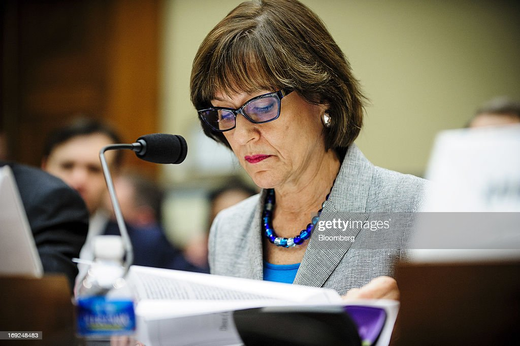 Lois Lerner, the director of the Internal Revenue Service's (IRS) exempt organizations office, looks through documents during a House Oversight and Government Reform Committee hearing in Washington, D.C., U.S., on Wednesday, May 22, 2013. Lerner, the mid-level IRS official at the center of a controversy over treatment of small-government groups, invoked her right not to testify after reading a statement denying that she had committed any crimes. Photographer: Pete Marovich/Bloomberg via Getty Images