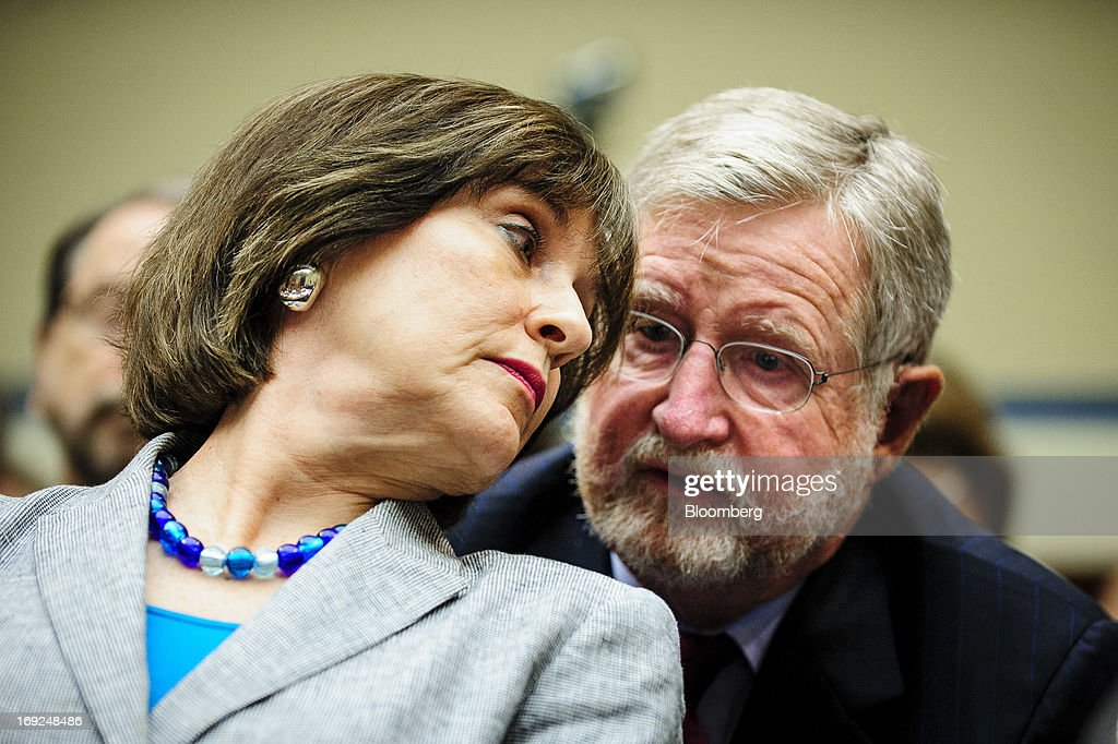 Lois Lerner, the director of the Internal Revenue Service's (IRS) exempt organizations office, left, confers with her attorney William W. Taylor during a House Oversight and Government Reform Committee hearing in Washington, D.C., U.S., on Wednesday, May 22, 2013. Lerner, the mid-level IRS official at the center of a controversy over treatment of small-government groups, invoked her right not to testify after reading a statement denying that she had committed any crimes. Photographer: Pete Marovich/Bloomberg via Getty Images