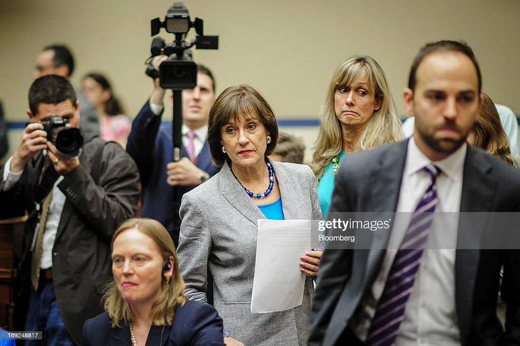 Lois Lerner, the director of the Internal Revenue Service's (IRS) exempt organizations office, center, arrives for a House Oversight and Government Reform Committee hearing in Washington, D.C., U.S., on Wednesday, May 22, 2013. Lerner, the mid-level IRS official at the center of a controversy over treatment of small-government groups, invoked her right not to testify after reading a statement denying that she had committed any crimes. Photographer: Pete Marovich/Bloomberg via Getty Images