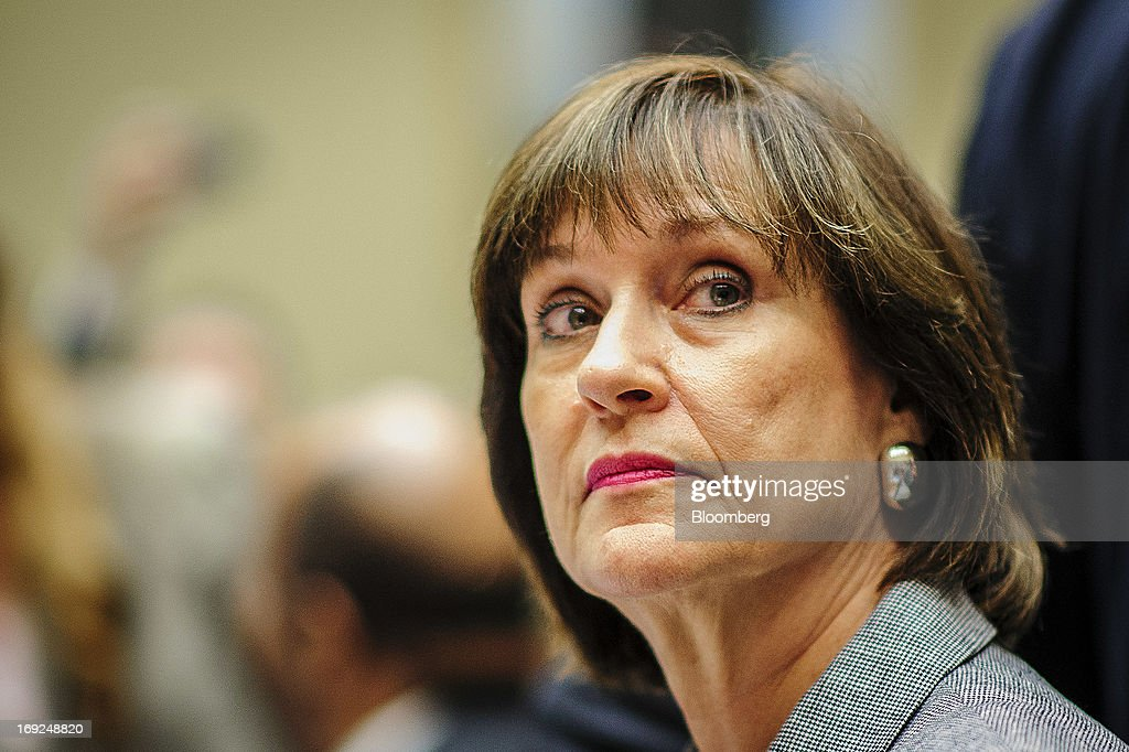 Lois Lerner, the director of the Internal Revenue Service's (IRS) exempt organizations office, listens during a House Oversight and Government Reform Committee hearing in Washington, D.C., U.S., on Wednesday, May 22, 2013. Lerner, the mid-level IRS official at the center of a controversy over treatment of small-government groups, invoked her right not to testify after reading a statement denying that she had committed any crimes. Photographer: Pete Marovich/Bloomberg via Getty Images