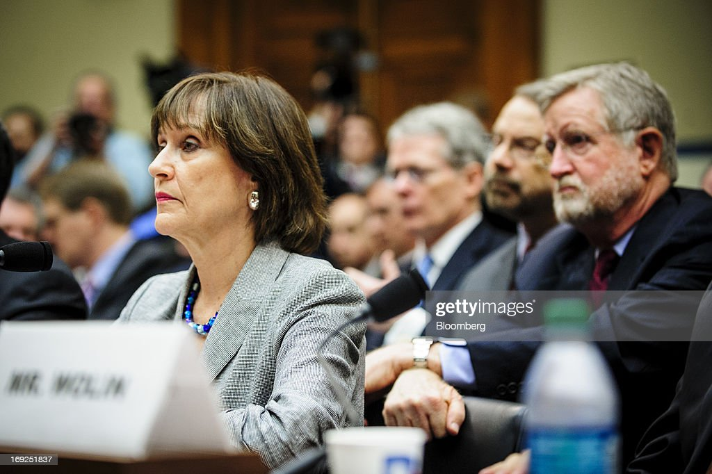 Lois Lerner, the director of the Internal Revenue Service's (IRS) exempt organizations office, left, listens during a House Oversight and Government Reform Committee hearing in Washington, D.C., U.S., on Wednesday, May 22, 2013. Lerner, the mid-level IRS official at the center of a controversy over treatment of small-government groups, invoked her right not to testify after reading a statement denying that she had committed any crimes. Photographer: Pete Marovich/Bloomberg via Getty Images