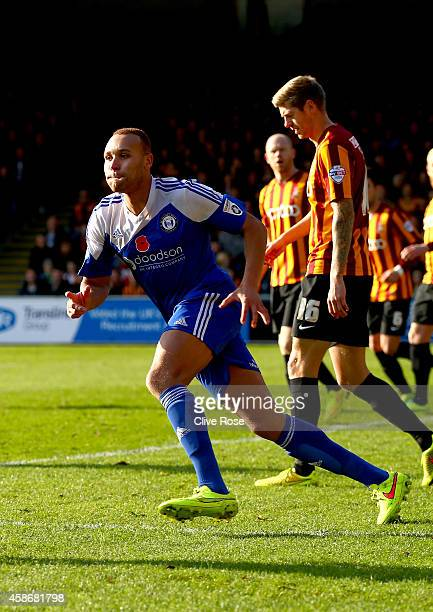 Lois Maynard of FC Halifax Town celebrates the opening goal during the FA Cup First Round match between FC Halifax and Bradford City on November 9...
