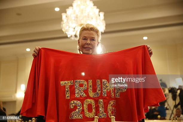 Lois Pope waits for the arrival of Republican presidential candidate Donald Trump to speaks during a press conference at the Trump National Golf Club...