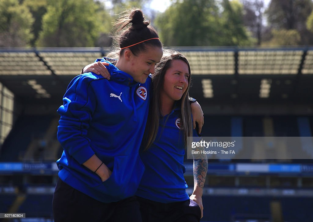 Lois Roche (L) and Kirsty McGee walk off the pitch ahead of the WSL 1 match between Reading FC Women and Sunderland AFC Ladies on May 2, 2016 in High Wycombe, England.