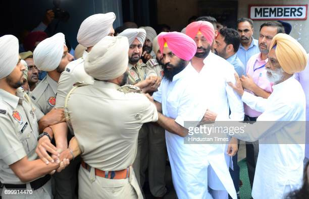 Lok Insaaf Party MLA Simarjit Singh Bains and AAP MLA Sukhpal Khaira trying to forcibly enter to Punjab Assembly on June 22 2017 in Chandigarh India
