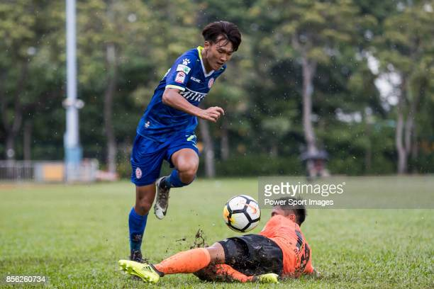 Lok Man Tang of BC Rangers fights for the ball with Ho Ming Yiu of Sun Bus Yeun Long during the Hong Kong Premier League Week 4 match between BC...
