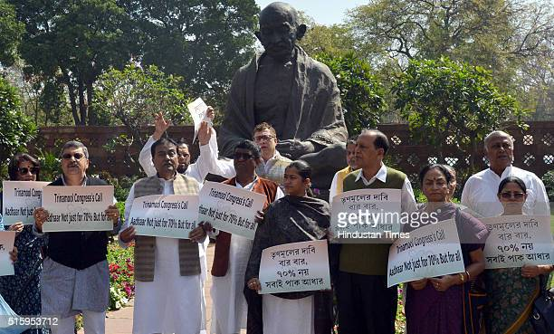 Lok Sabha and Rajya Sabha MPs protest on the Aadhar Card issue during the Parliament Budget Session on March 16 2016 in New Delhi India Just moments...