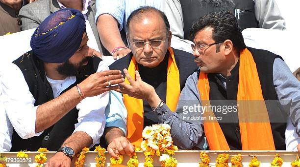 Lok Sabha candidate Arun Jaitley SAD Cabinet Minister Bikram Singh Majithia and State President BJP Kamal Shama sharing a point on March 18 2014 in...