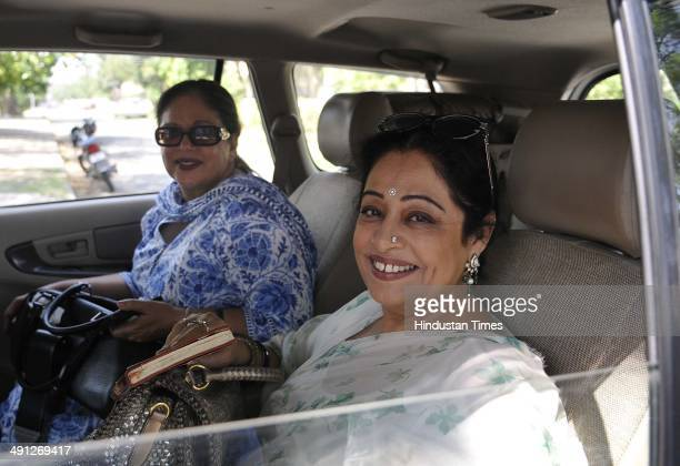 Lok Sabha Candidate from Chandigarh Kirron Kher enroute counting centre in Sector 26 on May 16 2014 in Chandigarh India Kirron Kher defeated...