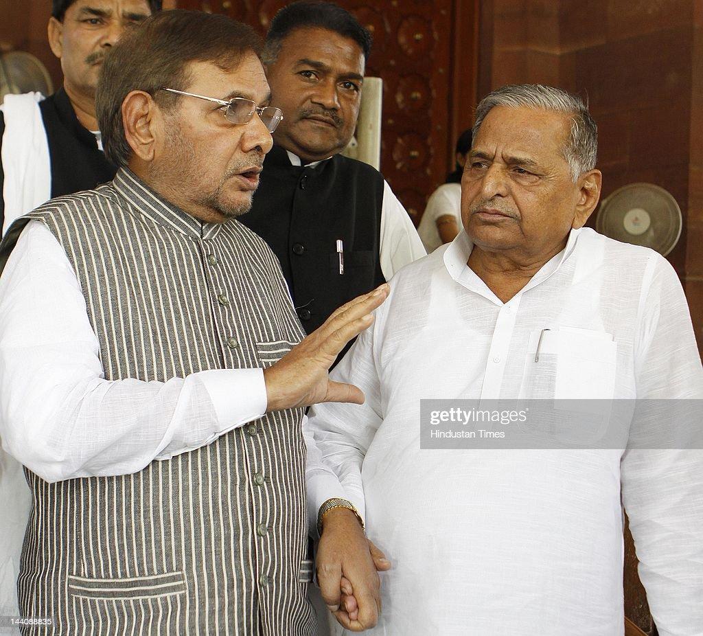 Lok Sabha MP and Samajwadi Party chief Mulayam Singh Yadav speaks with Sharad Yadav Janata Dal Chief after attending the ongoing budget session at...