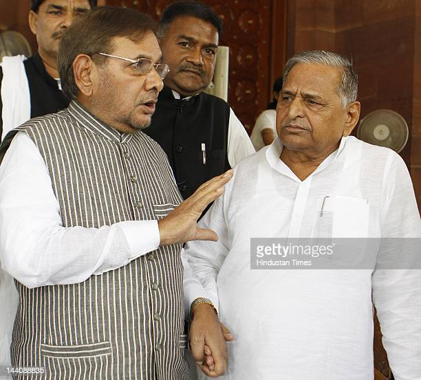 Lok Sabha MP and Samajwadi Party chief Mulayam Singh Yadav speaks with Sharad Yadav Janata Dal Chief after attending the ongoing budget session at...