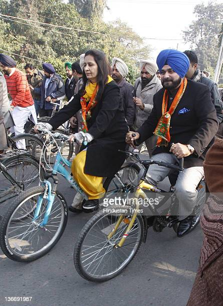 Lok Sabha MP from Amritsar and former International cricketer Navjot Singh Sidhu and his wife Navjot Kaur Sidhu riding bicycles to file her...