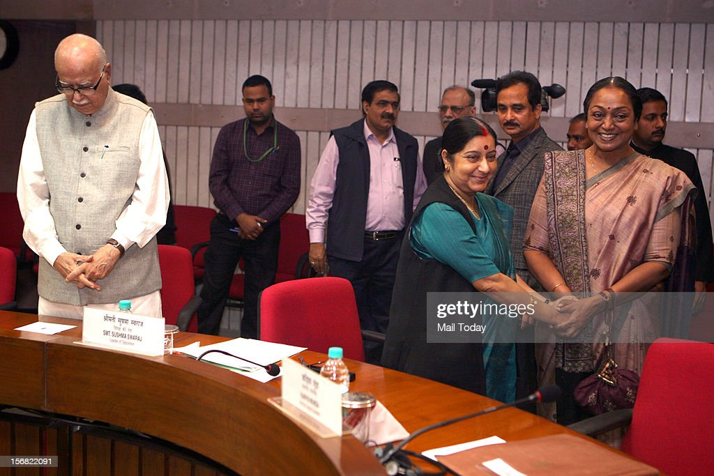 Lok Sabha Speaker Meira Kumar exchanges greetings with Leader of Opposition Sushma Swaraj also seen in the picture senior BJP leader LK Advani prior to an all-party meeting, convened by her, ahead of the Winter Session of Parliament in New Delhi on Wednesday. (Photo by Naveen Jora/India Today Group/Getty Images) Today Group/Getty Images)