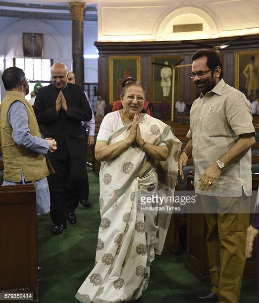 Lok Sabha Speaker Sumitra Mahajan with Minister of State for Parliamentary Affairs Mukhtar Abbas Naqvi after paying floral tributes to Lokmanya Bal...