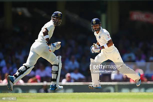 Lokesh Rahul of India and captain Virat Kohli run between the wickets during day three of the Fourth Test match between Australia and India at Sydney...