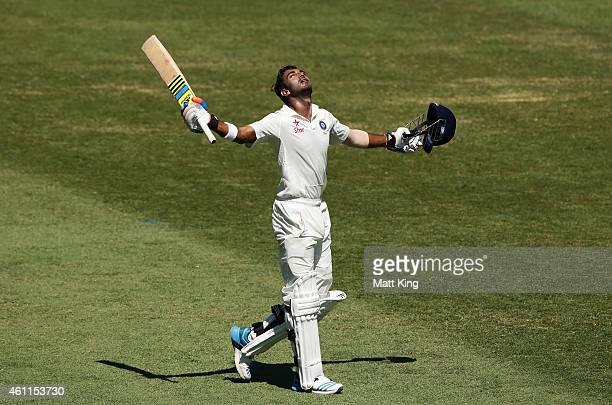 Lokesh Rahul of India celebrates and acknowledges the crowd after scoring a century during day three of the Fourth Test match between Australia and...