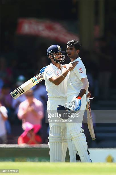 Lokesh Rahul of India celebrates scoring a century with captain Virat Kohli during day three of the Fourth Test match between Australia and India at...