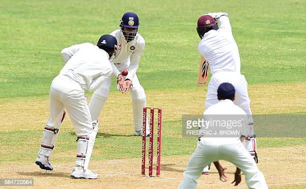 Lokesh Rahul of India fails to stop this shot from Devendra Bishoo of the West Indies off a delivery by bowler Ravichandran Ashwin in the 37th over...