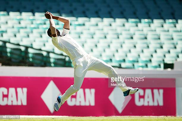Lokesh Rahul of India takes a catch on the boundary to dismiss Joe Burns of Australia during day two of the Fourth Test match between Australia and...