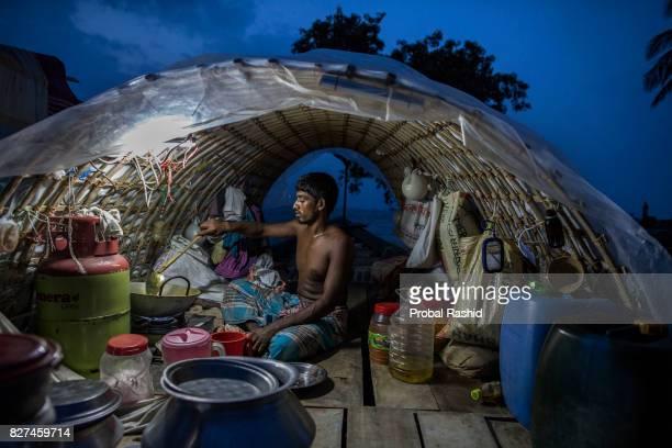 BHOLA BARISAL BANGLADESH BHOLA BARISAL BANGLADESH Lokman Miah is a fisherman cooking on a fishing boat in Bhola Bangladesh on August 1 2017The Bhola...