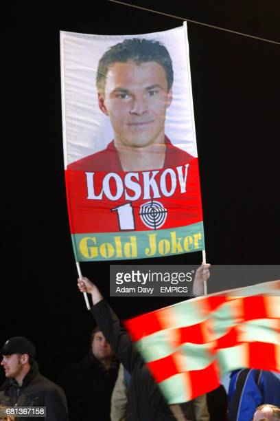 Lokomotiv Moscow fans hold a banner with their favourite player Dmitri Loskov