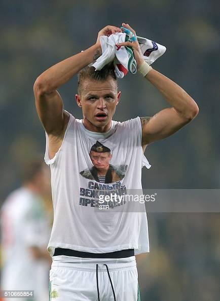Lokomotiv Moscow's Dmitri Tarasov wears a shirt showing Russian President Vladimir Putin that reads 'Most polite president' after the UEFA Europa...