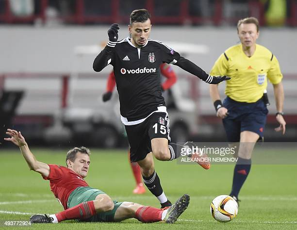 Lokomotiv's midfielder Aleksandr Kolomeytsev vies for the ball with Besiktas' midfielder Oguzhan Ozyakup during the UEFA Europa League group H...