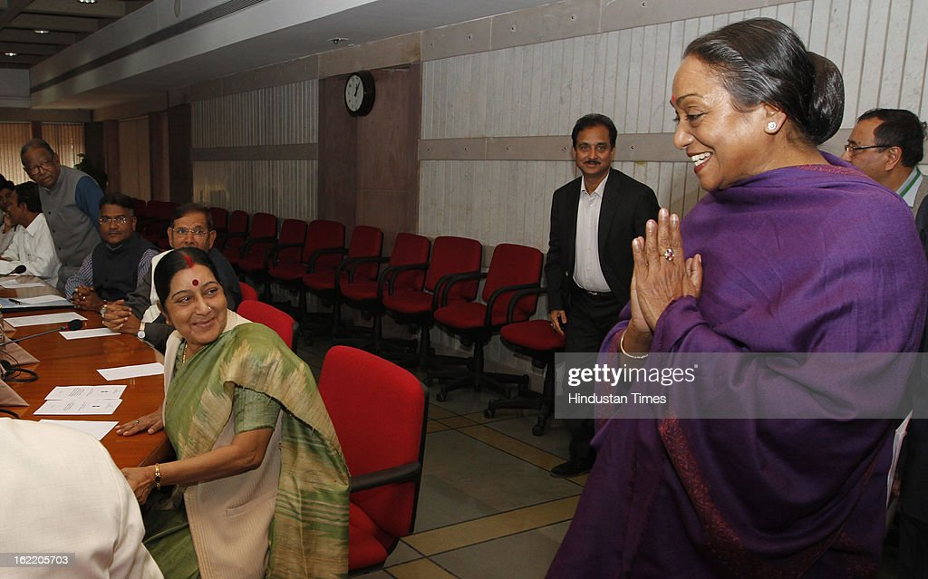 Loksabha Speaker Meira Kumar greeting BJP Leader Sushma Swaraj ( L ) and other leaders at a All party meeting called by Loksabha Speaker at Parliament House Library on February 20, 2013 in New Delhi, India. Parliament's budget session beginning on February 21, 2013 is expected to be stormy as chief opposition party BJP has announced that it would disrupt proceedings and take on the UPA government over bribery allegations on the $750-million in VVIP chopper deal. However strucking a conciliatory note Home minister Shinde Regretted his Saffron Terror remark.