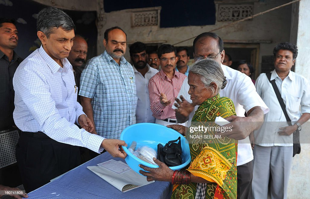 Loksatta Party Member of Legislative Assembly (MLA) Jayaprakash Narayan (L) distributes medical kits to leprosy patients during Anti Leprosy Week in Hyderabad on February 5, 2013. Leprosy currently affects approximately a quarter of a million people throughout the world, with 70 percent of these cases occurring in India. AFP PHOTO / Noah SEELAM