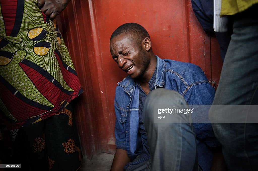 Lokuli Loleko Prince reacts to finding the body of his father in the Ndosho district of Goma in the east of the Democratic Republic of the Congo on November 21, 2012. Lokuli's father, a government military doctor, was killed in fighting yesterday between the government army and M23 rebels as they took the provincial capital. Lokuli and his two brothers came across his father's body by chance in the western district of Goma, having searched in the morgue and a hospital yesterday evening. The lightning seizure by rebels of Democratic Republic of Congo's city of Goma is a blow for President Joseph Kabila, but how far fighters will press forward their advantage is not clear, analysts say.