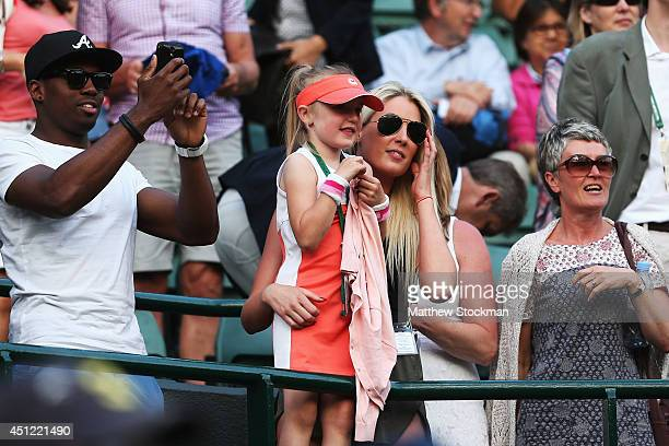 Lola 4 year old niece of Naomi Broady of Great Britain watches her Ladies' Singles second round match against Caroline Wozniacki of Denmark on day...