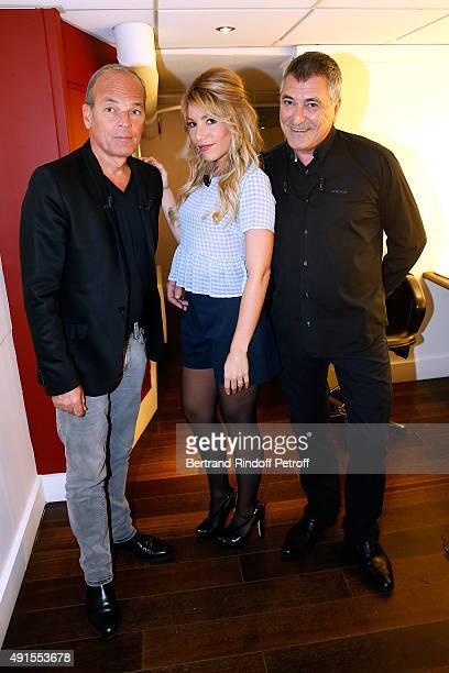 Lola Bigard standing between her husband Main Guest of the show Humorist JeanMarie Bigard and Laurent Baffie attend the 'Vivement Dimanche' French TV...