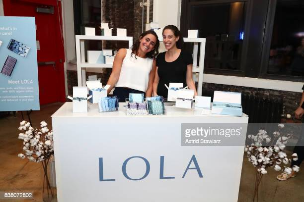 Lola CoFounders Jordana Kier and Alexandra Friedman pose with their booth during the 'CHAMPION EQUALITY MAKE IT YOUR BUSINESS' panel event hosted by...
