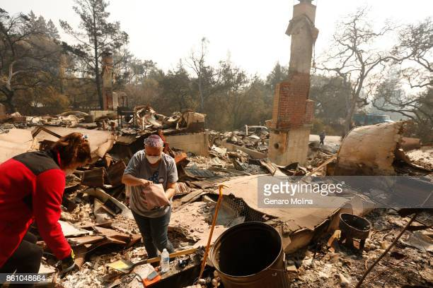 Lola Cornish left and her daughter Kat Corazza recover family jewelry that survived the fire and destruction of Cornish's grandfather's home to the...