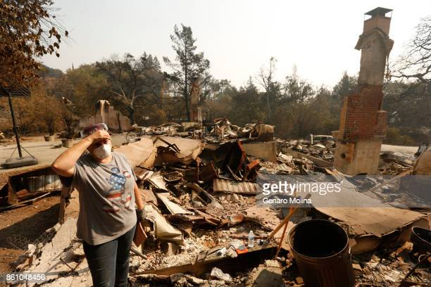 Lola Cornish stands in the rubble of her grandfather home victim to the Atlas fire in Napa on October 13 2017 Residents were allowed to return to a...